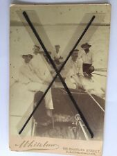 old antique vintage photo men in boat in Tasmania wearing white sailing clothes