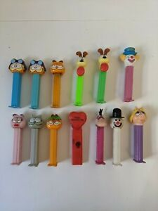 13 Vintage PEZ Dispensers- Garfield,Odie, Peter the clown, Dino, Ms Piggy + more