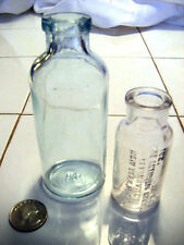 2 antique medicine bottles one embossed cylinder types Nice and clean Look