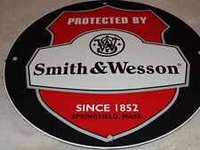 "VINTAGE PROTECTED BY SMITH & WESSON 11 3/4"" PORCELAIN METAL GASOLINE & OIL SIGN!"