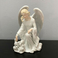 Enesco Angel And Animal in Snow Winter Figurine Designed By G.g. Santiago 1990
