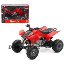 Motos et quads miniatures blancs sous boîte fermée Honda