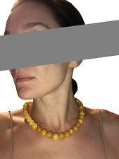 Collana di perle d'ambra baltica naturale color giallo antico...lunghezza 48,5cm