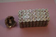 Une plaquette de 36 boutons de  nacre (4 trous), 11mm mercerie ancienne couture