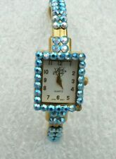 Kirks Folley with blue stones 1 in diagonal watch spring bands preowned