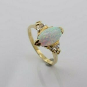 14K Yellow Gold Ring with Opal Stone and Cubic Zirconia