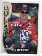 JEFF GORDON NASCAR AUTOGRAPHED CARD THE CARD IS IN ROUGH SHAPE
