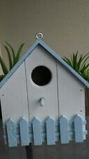 "Blue and white wood bird house size 9""tal 8""1/2 wide 5""1/2 deep"