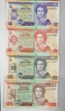 FOUR BELIZE BANKNOTES $2/ $5/ $10 & $20 IN NEAR MINT CONDITION.
