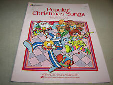 Popular Christmas Songs Primer Level Piano Music Book