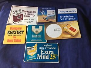 Collectable drink coasters Different Cigarettes x Fair to good condition x 7 (B)