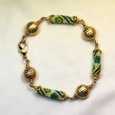 Bracelet made with Peytwist stitch, Delicas Beads, GF Beads, and GP Clasp