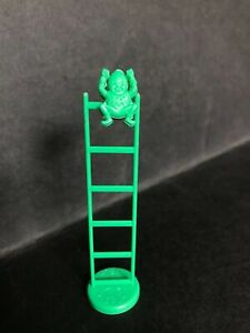 CEREAL TOY R&L CARNIVAL 1969 - TUMBLING CLOWN GREEN