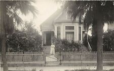 RPPC Postcard Victorian Cottage with woman in front yard Palm Trees Los Angeles?
