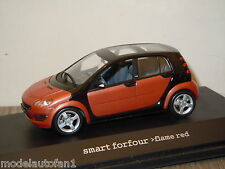 Smart Forfour Flame Red van Schuco 1:43 in Box *15393