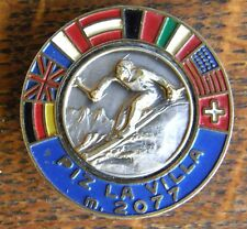 1920'S 8 COUNTRIES PICTORIAL SKIING BADGE HELD IN ITALY SILVER & ENAMELED FLAGS