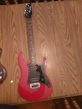 Red Ibanez Gio electric guitar