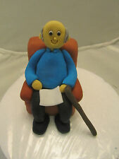man grandad in chair reading with walking stick ,edible birthday cake topper,