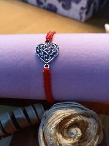 Red silk adjustable friendship bracelet with silver heart charm
