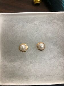 Marked 14k yellow gold pearl 5mm earrings , no backs.