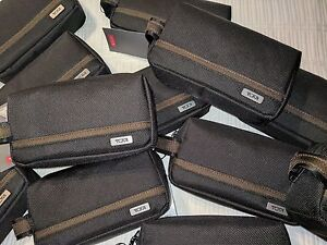 New With Tags   TUMI Cord Pouch  Black/Tan Rectangular Shape.