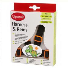 Brand new in box Clippasafe designer harness reins in dinosaur black and orange