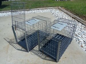 Tomahawk cat transfer cages (2). With plastic trays.