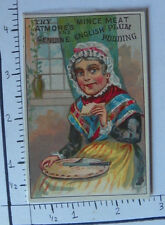 ATMORE'S MINCE MEAT ENGLISH PUDDING WOMAN PIE IN LAP EATING A SLICE KITCHEN 1538