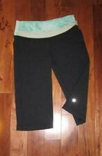 LULULEMON ASTRO CROPS BLACK AND MINTY GREEN PRINT size 6