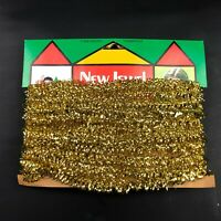 VINTAGE GARLAND /TINSEL CHRISTMAS ROPE New Old Stock NOS Gold Bright Shiny Tree