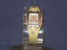 WOMENS RELIC WATCH W/BARREL SILVERTONE FACE,HANDS & NUMBERS W/GREEN BAND  P162