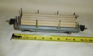 THE LIONEL LINES TIN No.811 FLAT CAR WOOD HAULER W/LOAD O SCALE 8 WHEEL