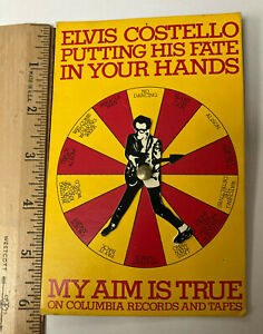 "Rare promo only Elvis Costello ""song spinner"" for the My Aim is True Album"