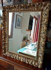 Specchio con antica cornice dorata in ceramica