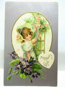 1910 POSTCARD MY HEART'S GIFT, GIRL WITH ROSES ON TRELLIS, VIOLETS