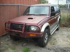 1995 MITSUBISHI PAJERO COLLECTION OF PARTS. LIGHTS,AIR COND, FRONT PARTS.