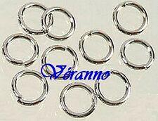 200 anneaux en métal 6 mm argenté. R7394