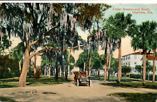 CEDAR AVENUE AND HOTEL, DAYTONA, FLA. FL. FLORIDA. OLD CAR. STREET SCENE.