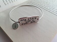 SILVER PLATED MY STORY ISN'T OVER YET WORD CHARM BANGLE CUFF BRACELET JEWELLERY
