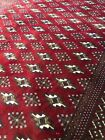 """Velvety  4'6""""x5'11"""" Persian Tekke hand-knotted wool rug with wine red field."""