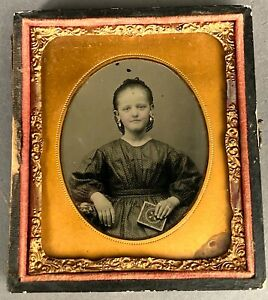 1/6 PLATE AMBROTYPE OF YOUNG GIRL HOLDING KNOWN UNION CASE, SHARP FOCUS