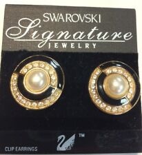 NWT SWAROVSKI SIGNATURE GOLD PEARL, CRYSTAL, AND BLACK ENAMEL CLIP ON EARRINGS