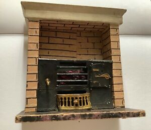 Antique dolls house soft metal range / stove with wooden surround