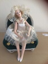 Vintage porcelain 1920s lady in cream, with movable arms and legs sat in a chair