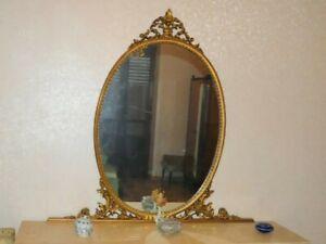 Specchiera ovale con cornice dorata