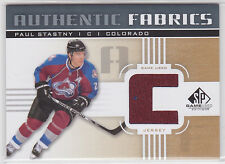 """Paul Stastny 2011 11/12 SP Game Used authentic fabrics gold """"C"""" Avalanche"""
