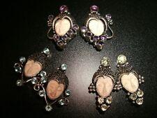 choice 1 carved face clip back earrings