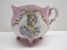 UNMARKED PORCELAIN LAVENDER FOOTED HAND PAINTED PORTAIT MUSTACHE CUP WITH GOLD