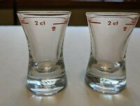"2 Shot Glasses Red Line 2 cl w/ Flower Symbol 2 11/16"" Tall Hourglass Shaped"
