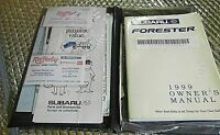 Factory Owners Manual 1999 Subaru Forester with folder & other papers